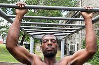 A man does pull-ups on monkey-bars in Vernon Park in East Germantown, Pennsylvania, on Tues., July 26, 2016.