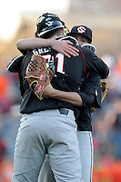 Closing pitcher Joel Seddon (6) of the South Carolina Gamecocks hugs catcher Grayson Greiner (21) after closing out the Reedy River Rivalry game against the Clemson Tigers on March 1, 2014, at Fluor Field at the West End. South Carolina won, 10-2. Seddon got the save.  (Tom Priddy/Four Seam Images)