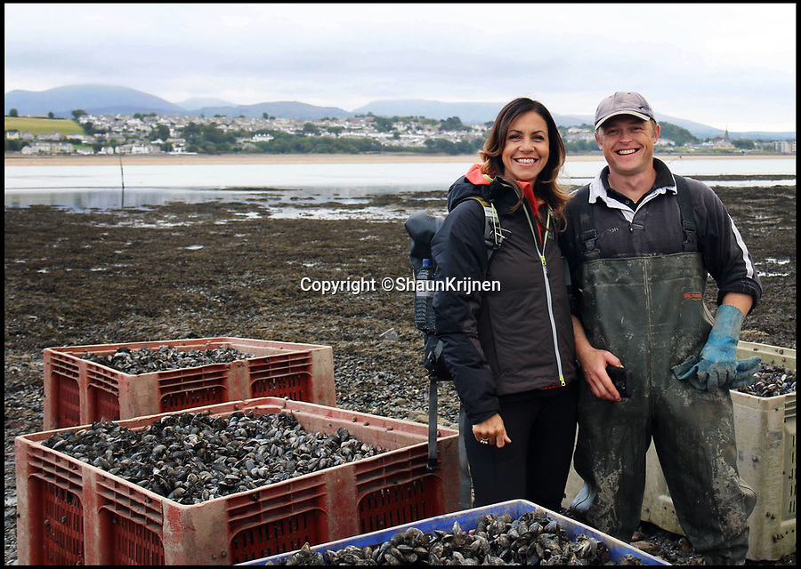 BNPS.co.uk (01202 558833)Pic: ShaunKrijnen/BNPS<br /> <br /> Oyster farmer Shaun Krijnen and Julia Bradbury from when Bradbury was filming a Countryfile episode.<br /> <br /> Claws for thought...<br /> <br /> Divers and fishermen will need to be careful not to have a run-in with the monster that left this giant claw behind.<br /> <br /> The massive lobster, which must be at least 50 years old and about 3ft in length, is believed to be lurking in the Menai Strait in Anglesea, Wales.<br /> <br /> Marine biologist and oyster farmer Shaun Krijnen found the huge crushing claw the crustacean had shed when he pulled in one of his oyster bags last week.<br /> <br /> The claw is bigger than a human hand at a whopping 8 inches and it would be powerful enough to squash a tin can or break a human wrist.