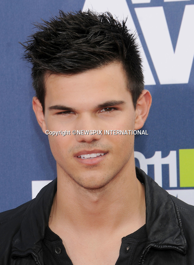 """TAYLOR LAUTNER.attends the 2011 MTV Movie Awards at the Gibson Amphitheatre on June 5, 2011 in Universal City, California.Mandatory Photo Credit: ©Crosby/Newspix International. .**ALL FEES PAYABLE TO: """"NEWSPIX INTERNATIONAL""""**..PHOTO CREDIT MANDATORY!!: NEWSPIX INTERNATIONAL(Failure to credit will incur a surcharge of 100% of reproduction fees)..IMMEDIATE CONFIRMATION OF USAGE REQUIRED:.Newspix International, 31 Chinnery Hill, Bishop's Stortford, ENGLAND CM23 3PS.Tel:+441279 324672  ; Fax: +441279656877.Mobile:  0777568 1153.e-mail: info@newspixinternational.co.uk"""