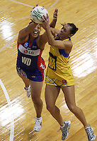 Mystics wing defence Finau Pulu and Ngarama Milner-Olsen compete for the ball during the ANZ Netball Championship match between the Central Pulse and Northern Mystics, TSB Bank Arena, Wellington, New Zealand on Monday, 4 May 2009. Photo: Dave Lintott / lintottphoto.co.nz