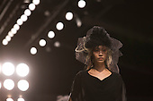 Saturday, 16 February 2013, London, England, UK. John Rocha catwalk show at Somerset House during London Fashion Week. His models sported elaborate hairstyles and headdresses. Photo: Bettina Strenske