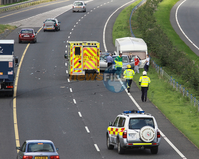 A two vehicle RTA on the M1 at castleblaney junction, Two cars one pulling a caravan collided together...Photo: Fran Caffrey/www.newsfile.ie...