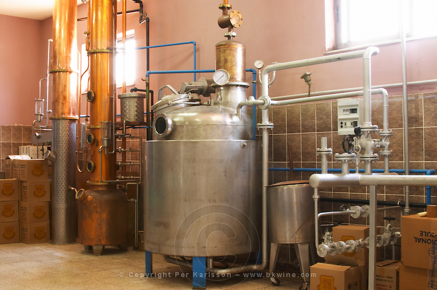 Distillation machine still with steel and copper boiler and column to make grape juice spirit. Kantina Miqesia or Medaur winery, Koplik. Albania, Balkan, Europe.