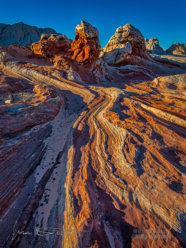 Ribbon of Rock - White Pocket, Arizona ©2018 James D Peterson.  Sunset shadows outline the twists and turns of this otherworldly sandstone formation in northern Arizona's Vermilion Cliffs National Monument.