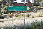 Volcanoes National Park & Amahoro Group Sign