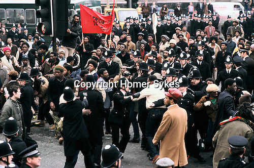NEW CROSS FIRE, SOUTH LONDON 1981 PEOPLE DEMONSTRATE ABOUT THE DEATH OF 13 PEOPLE, POLICE BLAMED, MARCH TO WESTEND, 1981 The New Cross Fire was a devastating house fire which killed 13 young black people during a birthday party in New Cross, southeast London on Sunday 18 January 1981. Some were shocked by what they perceived as the indifference of the white population, and accused the London Metropolitan Police of covering up the cause, which they suspected was an arson attack motivated by racism; the protests arising out of the fire led to a mobilisation of black political activity. Nobody has ever been charged in relation to the fire