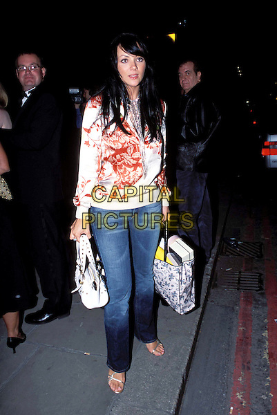 MARTINE McCUTCHEON.Lycra British Style Awards 2003, Old Billingsgate Market, EC3.jeans, denim, casual, goody bag, silk, satin, floral print, top.www.capitalpictures.com.sales@capitalpictures.com.© Capital Pictures