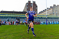 Sam Nixon and the rest of the Bath United team run onto the field. Premiership Rugby Shield match, between Bath United and Gloucester United on April 8, 2019 at the Recreation Ground in Bath, England. Photo by: Patrick Khachfe / Onside Images