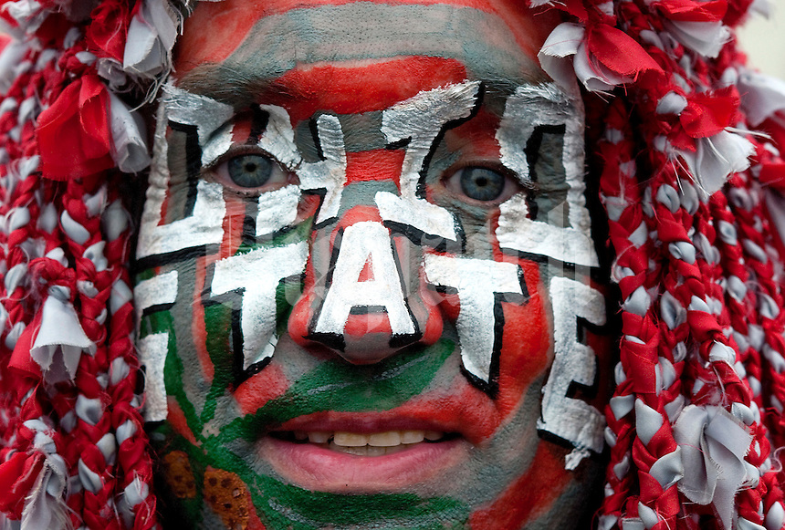 Rex Staley is adorned in face paint and a weaved scarlet and gray handmade wig, as he was watching the Ohio State vs Michigan State game at the River Jam, at River Watch Tower, Saturday, October 1, 2011. (Dispatch photo by Ty Wright)