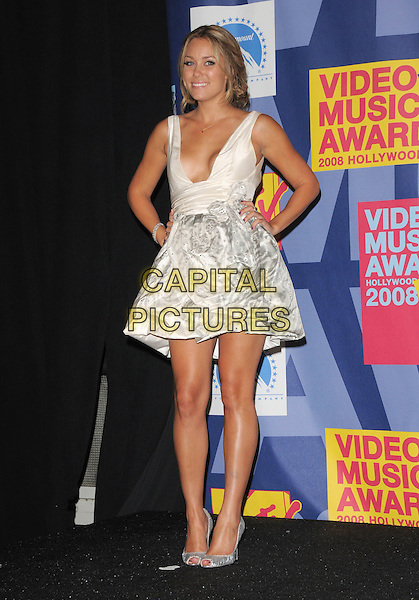 LAUREN CONRAD.The 2008 MTV Video Music Awards held at Paramount Studios in Hollywood, California, USA..September 7th, 2008.Pressroom VMA Vmas full length dress hand on hip white top grey gray skirt silver low cut plunging neckline clutch bag shoes .CAP/DVS.©Debbie VanStory/Capital Pictures.