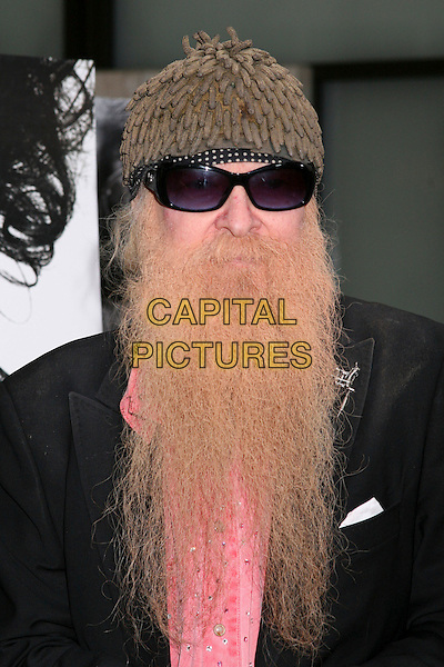 "BILLY GIBBONS - ZZ TOP.HBO's ""Deadwood"" Season Premiere at the Cinerama Dome, Hollywood, California, USA..June 6th, 2006.Photo: Byron Purvis/AdMedia/Capital Pictures.Ref: BP/ADM.headshot portrait beard facial hair hat sunglasses shades.www.capitalpictures.com.sales@capitalpictures.com.© Capital Pictures."