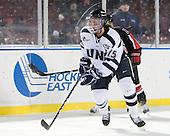 Raylen Dziengelewski (UNH - 15) - The University of New Hampshire Wildcats defeated the Northeastern University Huskies 5-3 (EN) on Friday, January 8, 2010, at Fenway Park in Boston, Massachusetts as part of the Sun Life Frozen Fenway doubleheader.
