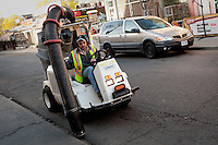 A man operates a ATLV 4300 street cleaner in Toronto April 19, 2010.