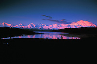 Mount McKinley with alpenglow at sunsetreflected on Lake Wonder. Denali National Park, Alaska.