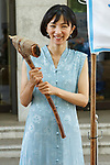 Japanese actress and singer Hikari Mitsushima holds a stone axe during a news conference at the National Museum of Nature and Science in Tokyo on July 31, 2018, Tokyo, Japan. The museum aims to collect 30 million yen to recreate the Japanese ancestors' journey between Taiwan and Yonaguni Island on a wooden dugout canoe. (Photo by Rodrigo Reyes Marin/AFLO)