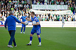 St Johnstone v Celtic.....12.04.11.Danny Grainger and groundsman Chris Smith clears the pitch of balls after they were thrown on by Celtic fans in protest against the 6 o'clock kick off.Picture by Graeme Hart..Copyright Perthshire Picture Agency.Tel: 01738 623350  Mobile: 07990 594431