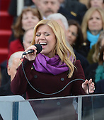 Kelly Clarkson sings after President Barack Obama was sworn-in for a second term as the President of the United States by Supreme Court Chief Justice John Roberts during his public inauguration ceremony at the U.S. Capitol Building in Washington, D.C. on January 21, 2013.      .Credit: Pat Benic / Pool via CNP