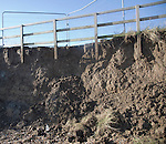 Storm damage to coastal path and crumbling cliff face at East Lane, Bawdsey, Suffolk, England