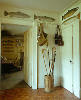 The small entrance hall to the fishing lodge has a basket for walking sticks and hooks for fishing bags and binoculars