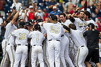 Vanderbilt Commodores celebrates their walk off victory during NCAA College baseball World Series against the Cal State Fullerton Titans on June 15, 2015 at TD Ameritrade Park in Omaha, Nebraska. Vanderbilt beat Cal State Fullerton 4-3. (Andrew Woolley/Four Seam Images)