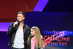 Nicky Byrne presents the 2011 Cheerios Childline Concert in the O2...(Photo credit should read Jenny Matthews www.newsfile.ie)....This Picture has been sent you under the conditions enclosed by:.Newsfile Ltd..The Studio,.Millmount Abbey,.Drogheda,.Co Meath..Ireland..Tel: +353(0)41-9871240.Fax: +353(0)41-9871260.GSM: +353(0)86-2500958.email: pictures@newsfile.ie.www.newsfile.ie.