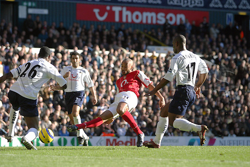13 November 2004: Arsenal striker Thierry Henry shoots past Ledley King during the Premiership match between Tottenham Hotspur and Arsenal. Arsenal won the game played at White Hart Lane 5-4. Photo: Action Plus..041113 soccer football premier league premiership player players footballer footballers