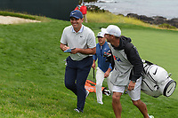 Francesco Molinari (ITA) shares a laugh with his caddie ad they depart the green on 8 during round 1 of the 2019 US Open, Pebble Beach Golf Links, Monterrey, California, USA. 6/13/2019.<br /> Picture: Golffile | Ken Murray<br /> <br /> All photo usage must carry mandatory copyright credit (© Golffile | Ken Murray)