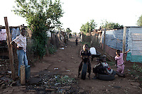 KHUTSONG, SOUTH AFRICA - OCTOBER 16: Daily life on October 16, 2012, in Khutsong, South Africa. Khutsong, a black township. is located about 56 miles west of Johannesburg, and surrounded by gold mines. Because of recent strikes many mineworkers has been fired which is making the poverty worse here. The communal toilets are dirty and often broken. (Photo by Per-Anders Pettersson)