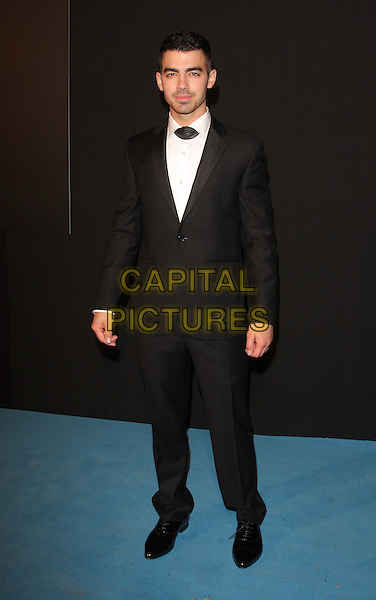 Joe Jonas.Grey Goose Winter Ball at the Battersea Evolution, London, England..29th October 2011.full length black suit tie collar wrap neck.CAP/ROS.©Steve Ross/Capital Pictures..