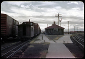 Antonito - Standard gauge freight cars and a narrow gauge caboose on dual gauge track.<br /> D&amp;RGW  Antonito, CO  9/9/1960
