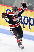 Katie MacSorley (Northeastern - 3) celebrates Llanes' goal. - The Northeastern University Huskies defeated the Boston College Eagles in a shootout on Monday, January 31, 2012, in the opening round of the 2012 Women's Beanpot at Walter Brown Arena in Boston, Massachusetts. The game is considered a 1-1 tie for NCAA purposes.