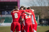 Billy Kee of Accrington Stanley (29) is mobbed after scoring his side's first goal during the Sky Bet League 2 match between Newport County and Accrington Stanley at Rodney Parade, Newport, Wales on 28 March 2016. Photo by Mark  Hawkins.