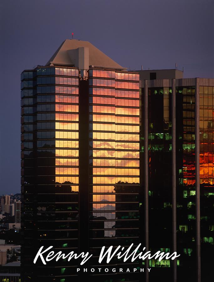 Sunset Reflecting on Modern Glass & Steel Skyscraper Building, Downtown Honolulu, Oahu, Hawaii, USA.