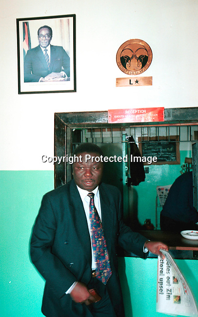dicozim00125 Morgan Tsvangirai, the MDC (Movement for democratic change) leader, stopping in rural Zimbabwe on his way to vote during the parlamentary elections in Zimbabwe on June 24-25, 2000. Mr Tsvangirai is a serious threat to President Robert Mugabe in the upcoming presidental elections in 2002;pic of Mugabe in the background.  .©Per-Anders Pettersson /iAfrika Photos