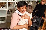 Education preschool 2-4 year olds affectionate moment female teacher hugging girl horizontal