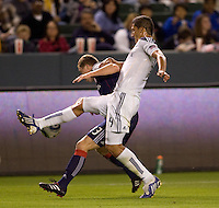 LA Galaxy defender Omar Gonzalez defends against  battles New England Revolution midfielder Joseph Niouky. The LA Galaxy defeated the New England Revolution 1-0 at Home Depot Center stadium in Carson, California on Saturday evening March 27, 2010.  .