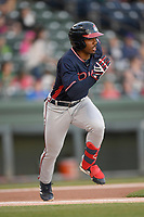 Right fielder Justin Dean (5) of the Rome Braves runs out a hit in a game against the Greenville Drive on Friday, April 19, 2019, at Fluor Field at the West End in Greenville, South Carolina. Greenville won, 2-0. (Tom Priddy/Four Seam Images)