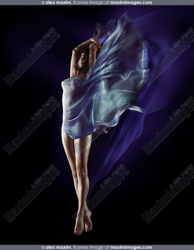 Sensual surreal photo of a beautiful naked woman with flowing blue cloth wrapping her nude body and fluttering like wings on black background