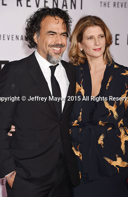 HOLLYWOOD, CA - DECEMBER 16: Director/writer Alejandro Gonzalez Inarritu (L) and Maria Eladia Hagerman arrive at the Premiere of 20th Century Fox And Regency Enterprises' 'The Revenant' at TCL Chinese Theatre on December 16, 2015 in Hollywood, California.