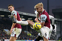 Burnley's James Tarkowski looks on as Ben Mee battles with Crystal Palace's Cheikhou Kouyate<br /> <br /> Photographer Rich Linley/CameraSport<br /> <br /> The Premier League - Burnley v Crystal Palace - Saturday 30th November 2019 - Turf Moor - Burnley<br /> <br /> World Copyright © 2019 CameraSport. All rights reserved. 43 Linden Ave. Countesthorpe. Leicester. England. LE8 5PG - Tel: +44 (0) 116 277 4147 - admin@camerasport.com - www.camerasport.com
