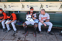 OAKLAND, CA - JUNE 7:  Matt Wieters and Ty Wigginton of the Baltimore Orioles get ready in the dugout before the game against the Oakland Athletics at the Oakland Coliseum in Oakland, California on Sunday, June 7, 2009.  The Athletics defeated the Orioles 3-0.  Photo by Brad Mangin