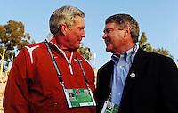 Jan 7, 2010; Pasadena, CA, USA; Texas Longhorns head coach Mack Brown (left) talks with BCS commissioner John Swofford before the 2010 BCS national championship game against the Alabama Crimson Tide at the Rose Bowl.  Mandatory Credit: Mark J. Rebilas-
