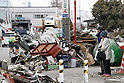 March 28, 2011, Ishonomaki, Japan - Piles of damaged furniture and home appliances are seen everywhere in Ishinomaki, Miyagi prefecture, on Monday, March 28, 2011, as reconstruction efforts have started. Ishinomaki, an industrial port some 350km northeast of Tokyo, is one of the hardest-hit areas in northeast Japan by the March 11 magnitude 9.0 earthquake and the subsequent 10-meter tsunami. Much of the town still remains submerged in muddy waters, which have hampered the efforts of people searching for missing kin and reconstruction. (Photo by AFLO) [3609] -mis-