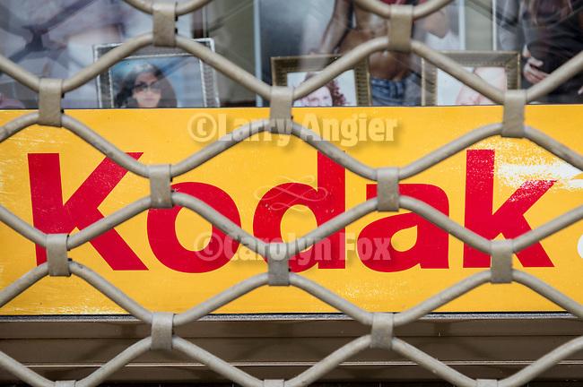 Kodak sign behind closed grating, Serbia