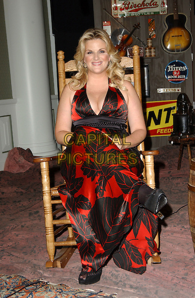 TRISHA YEARWOOD.Songs of the Year Taping Presented by Cracker Barrel held at Schermerhorn Symphony Center, Nashville, Tennessee, USA, 05 November 2006..full length sitting in chair red and black patterned dress print.Ref: ADM/GS.www.capitalpictures.com.sales@capitalpictures.com.©George Shepherd/AdMedia/Capital Picture.