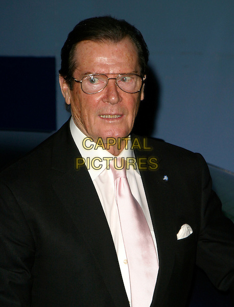 ROGER MOORE .Sony Ericsson Empire Film Awards 2006,.Hilton London Metropole, Edgware Road, London,.England, March 13th 2006..half length.Ref: AH.www.capitalpictures.com.sales@capitalpictures.com.©Adam Houghton/Capital Pictures.