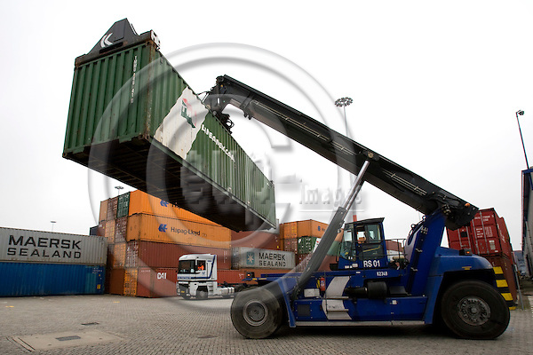 ROTTERDAM - NETHERLAND - 21 FEBRUARY 2008 -- Port of Rotterdam -- Container handlers in action and a truck waiting to be loaded.  Photo: Erik Luntang/EUP-IMAGES