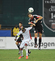 Dejan Jakovic (5) of D.C. United heads the ball against Dimitry Imbongo (92) of the New England Revolution. The New England Revolution defeated D.C. Untied 2-1, at RFK Stadium, Saturday July 27 , 2013.
