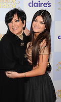 HOLLYWOOD, CA - MARCH 17: Kris Jenner and Kylie Jenner arrive at the 'Mirror Mirror' Los Angeles Premiere at Grauman's Chinese Theatre on March 17, 2012 in Hollywood, California.